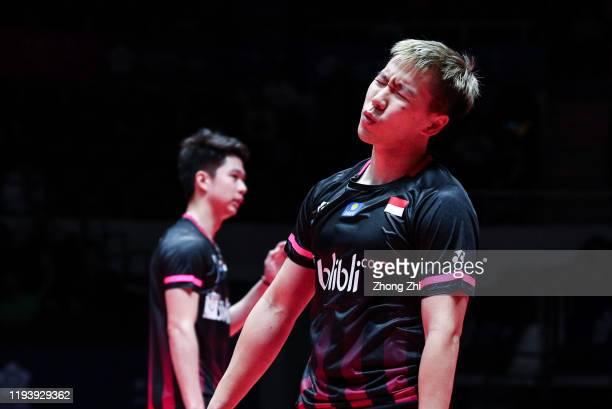 Marcus Fernaldi Gideon and Kevin Sanjaya Sukamuljo of Indonesia react during the men's doubles semi final match against Hiroyuki Endo and Yuta...