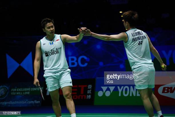Marcus Fernaldi Gideon and Kevin Sanjaya Sukamuljo of Indonesia react in the Men's Doubles quarterfinal match against Aaron Chia and Soh Wooi Yik of...