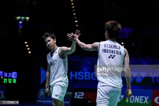 Marcus Fernaldi Gideon and Kevin Sanjaya Sukamuljo of Indonesia react in the Men's Double final match against Hiroyuki Endo and Yuta Watanabe of...