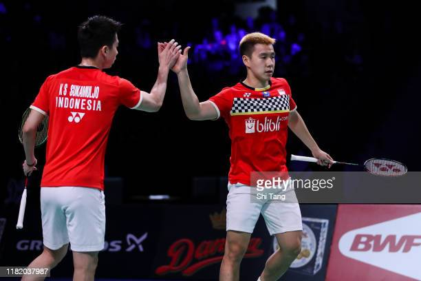 Marcus Fernaldi Gideon and Kevin Sanjaya Sukamuljo of Indonesia celebrate the victory in the Men's Doubles semi finals match against Lu Ching Yao and...
