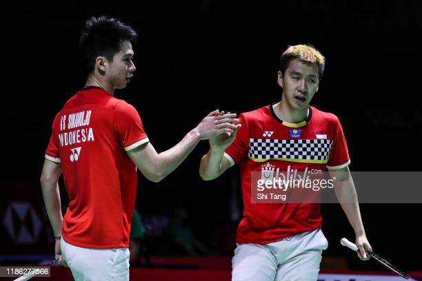 Marcus Fernaldi Gideon and Kevin Sanjaya Sukamuljo of Indonesia celebrate the victory in the Men's Doubles quarter finals match against Mark Lamsfuss...