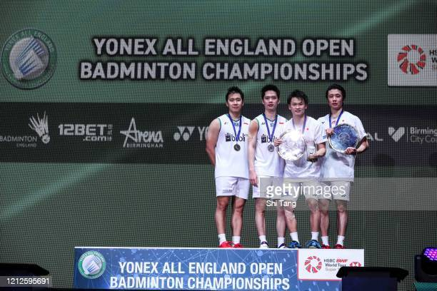 Marcus Fernaldi Gideon and Kevin Sanjaya Sukamuljo of Indonesia Yuta Watanabe and Hiroyuki Endo of Japan pose with their trophies after the Men's...