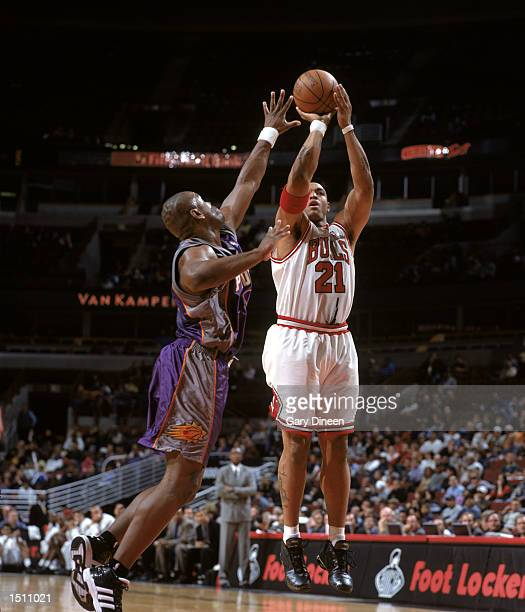Marcus Fizer of the Chicago Bulls shoots over defender Alton Ford of the Phoenix Suns during the NBA preseason game at the United Center in Chicago...