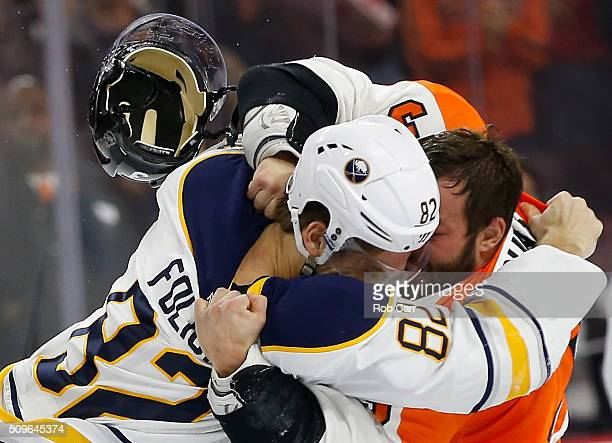 Marcus Foligno of the Buffalo Sabres and Radko Gudas of the Philadelphia Flyers fight in the second period at Wells Fargo Center on February 11 2016...