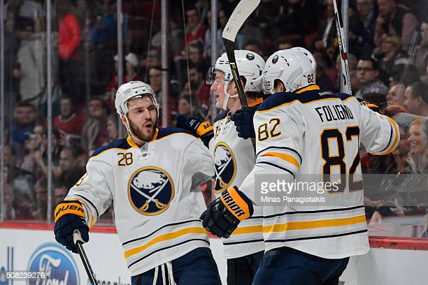 Marcus Foligno of the Buffalo Sabres celebrates his goal with teammates during the NHL game against the Montreal Canadiens at the Bell Centre on...