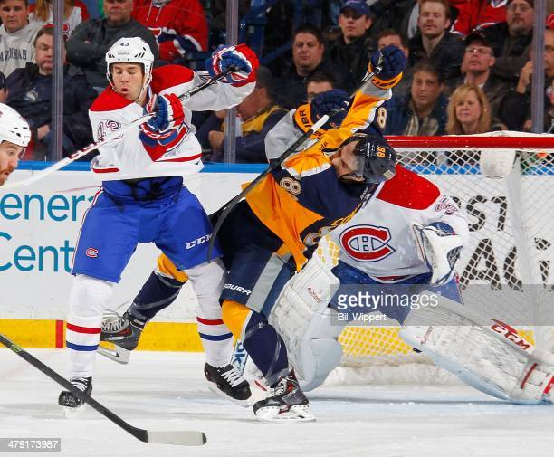 Marcus Foligno of the Buffalo Sabres gets upended by Mike Weaver of the Montreal Canadiens on March 16, 2014 at the First Niagara Center in Buffalo,...