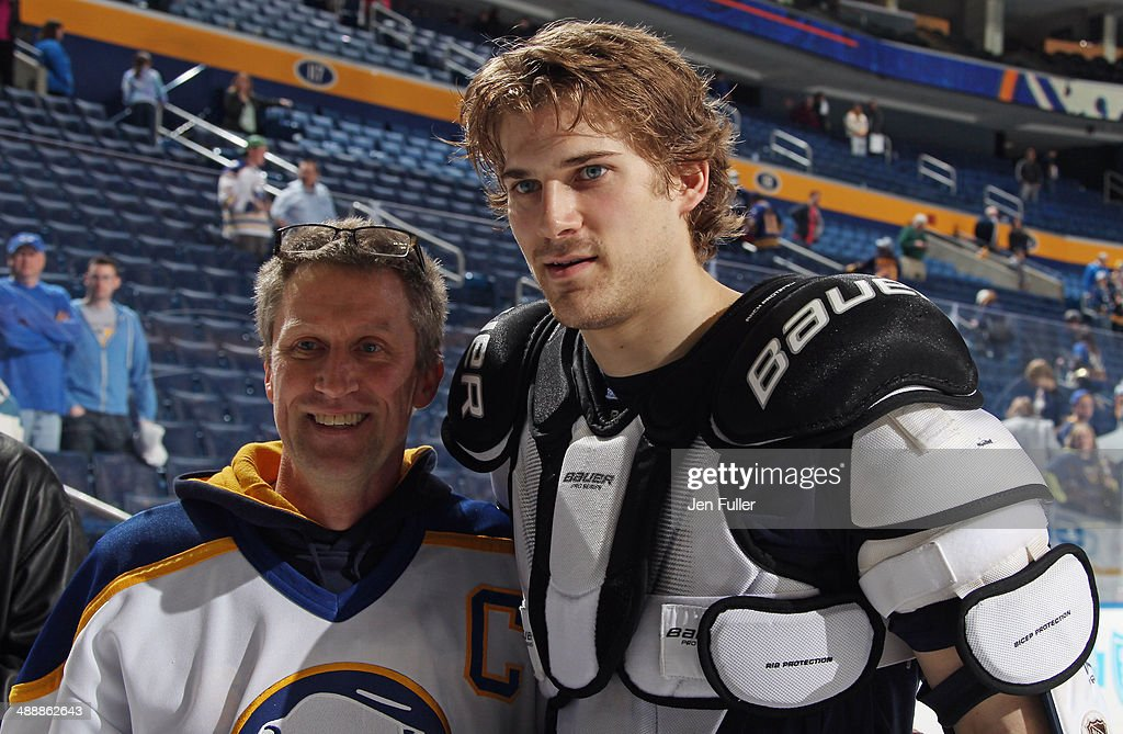 Marcus Foligno #82 of the Buffalo Sabres greets a fan after playing the New York Islanders at First Niagara Center on April 13, 2014 in Buffalo, New York.