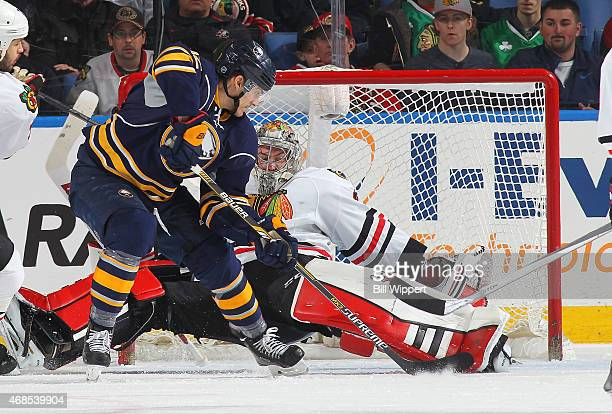 Marcus Foligno of the Buffalo Sabres scores a second period goal against Scott Darling of the Chicago Blackhawks on April 3 2015 at the First Niagara...