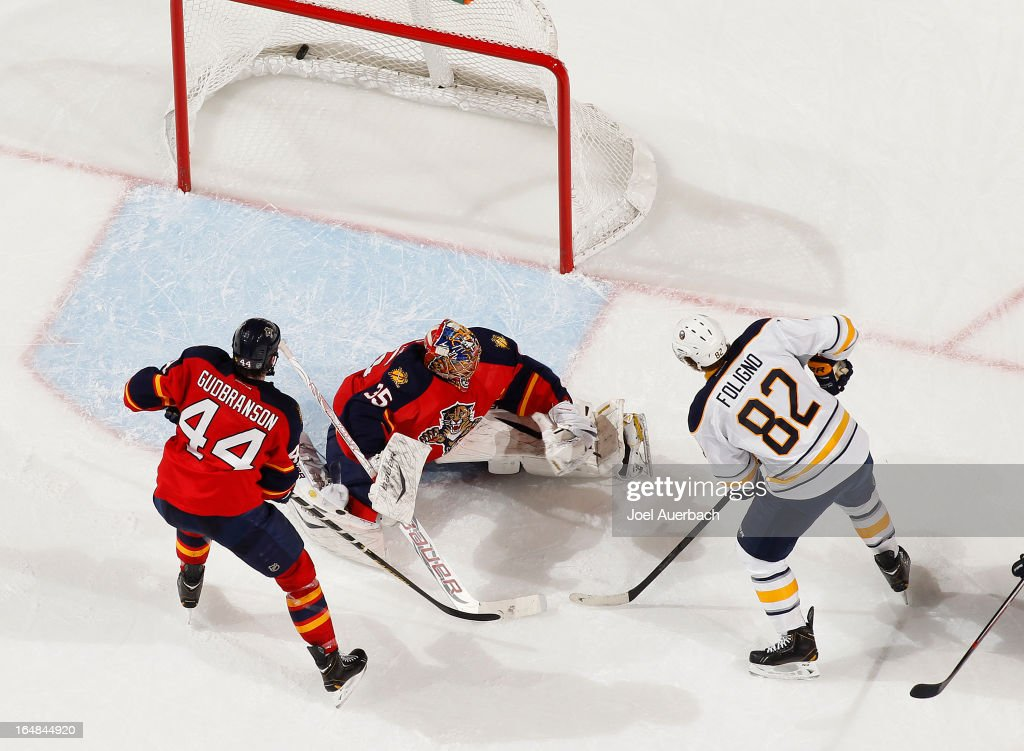 Marcus Foligno #82 of the Buffalo Sabres scores on a wrist shot past goaltender Jacob Markstrom #35 of the Florida Panthers at the BB&T Center on March 28, 2013 in Sunrise, Florida. The Panthers defeated the Sabres 5-4 in a shoot out.