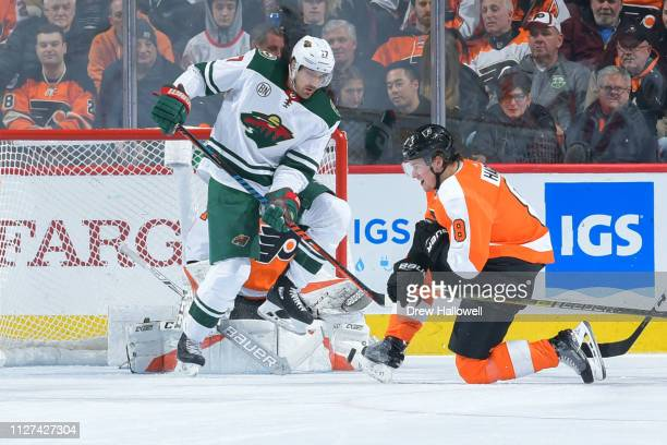 Marcus Foligno of the Minnesota Wild and Radio Gudas of the Philadelphia Flyers react to a shot at Wells Fargo Center on January 14 2019 in...
