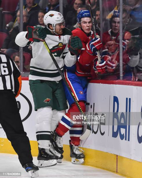 Marcus Foligno of the Minnesota Wild checks Cale Fleury of the Montreal Canadiens against the boards during the first period at the Bell Centre on...