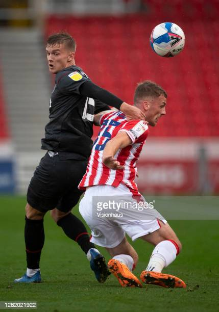 Marcus Forss of Brentford and Josh Tymon of Stoke City in action during the Sky Bet Championship match between Stoke City and Brentford at Bet365...