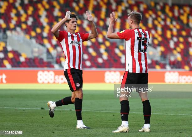 Marcus Forss of Brentford celebrating his teams second goal during the Sky Bet Championship match between Brentford and Huddersfield Town at Griffin...
