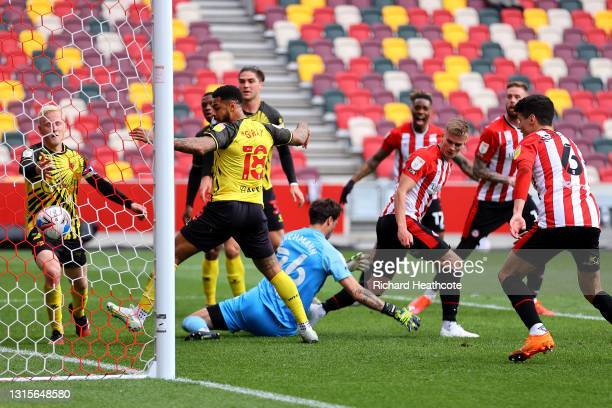 Marcus Forss of Brentford scores their side's first goal which is later ruled out for offside during the Sky Bet Championship match between Brentford...