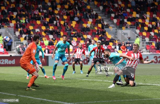 Marcus Forss of Brentford scores their side's third goal past Asmir Begovic of AFC Bournemouth during the Sky Bet Championship Play-off Semi Final...