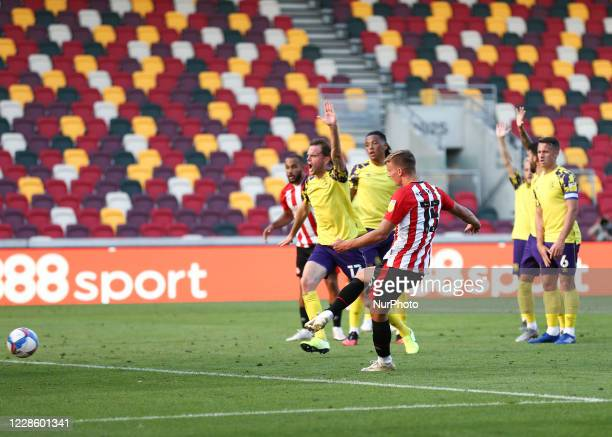 Marcus Forss of Brentford scoring his teams second goal during the Sky Bet Championship match between Brentford and Huddersfield Town at Griffin...