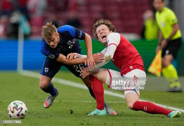 Marcus Forss of Finland battles for possession with Andreas Skov Olsen of Denmark during the UEFA Euro 2020 Championship Group B match between...