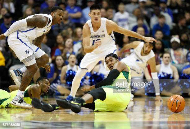 Marcus Foster and Martin Krampelj of the Creighton Bluejays scramble alongside Terry Maston of the Baylor Bears for a loose ball during the National...