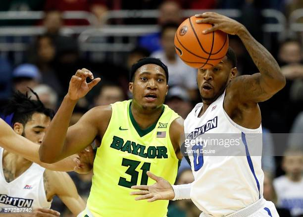 Marcus Foster of the Creighton Bluejays and Terry Maston of the Baylor Bears compete for a loose ball during the National Collegiate Basketball Hall...