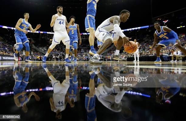 Marcus Foster of the Creighton Bluejays controls the ball under the basket as Aaron Holiday of the UCLA Bruins defends during the National Collegiate...