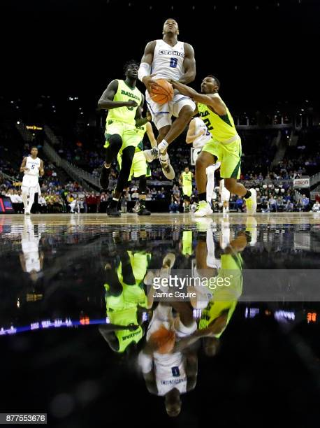 Marcus Foster of the Creighton Bluejays drives toward the basket as King McClure of the Baylor Bears defends during the National Collegiate...