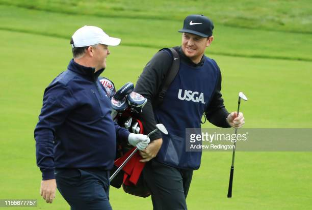 Marcus Fraser of Australia and his caddie and ex-AFL player, Brendon Goddard, walk off the third hole during the first round of the 2019 U.S. Open at...