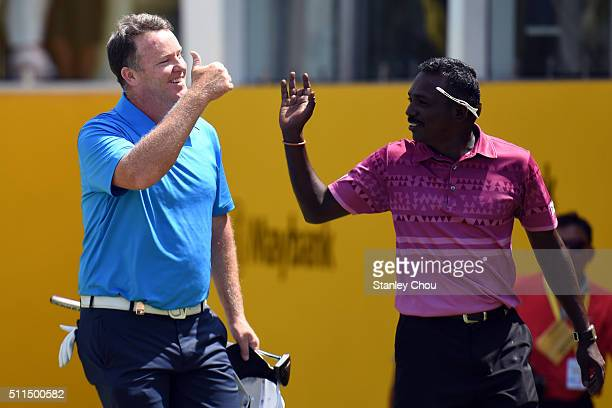 Marcus Fraser of Australia celebrates with a caddie on the 18th hole after winning the Championship during the fourth round of the Maybank...
