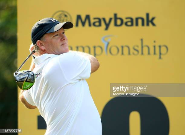 Marcus Fraser of Australia hits his teeshot on the 18th hole on Day One of the Maybank Championship at Saujana Golf Country Club Palm Course on March...