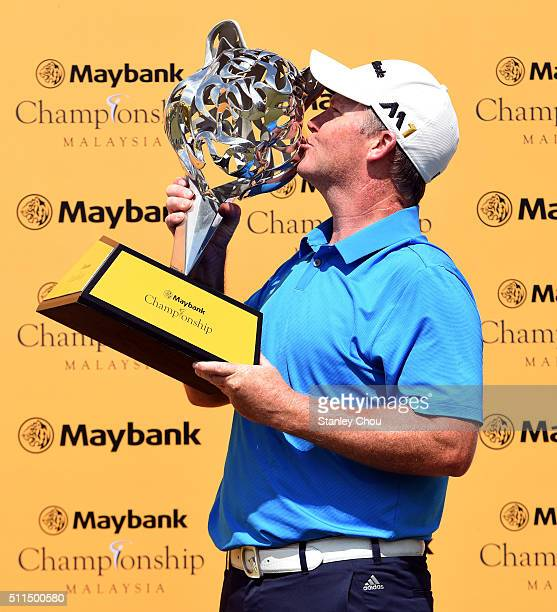 Marcus Fraser of Australia kisses the Maybank Championship Tropy after he won it 66 269 during the fourth round of the Maybank Championship Malaysia...
