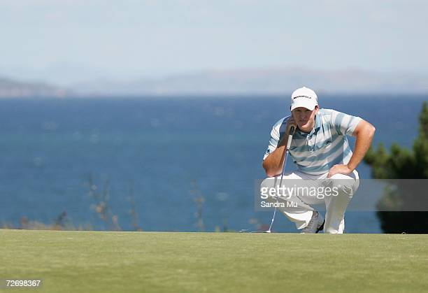 Marcus Fraser of Australia lines up a putt on the 16th hole during round three of the New Zealand Open at Gulf Harbour Country Club on the...