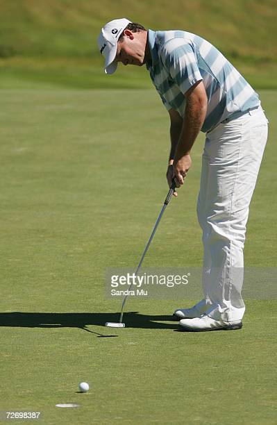 Marcus Fraser of Australia makes a putt on the 16th hole during round three of the New Zealand Open at Gulf Harbour Country Club on the Whangaparoa...