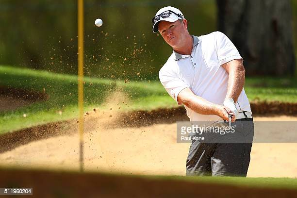 Marcus Fraser of Australia plays from a green side bunker on the 5th hole during the ProAm ahead of the 2016 Perth International at Lake Karrinyup...