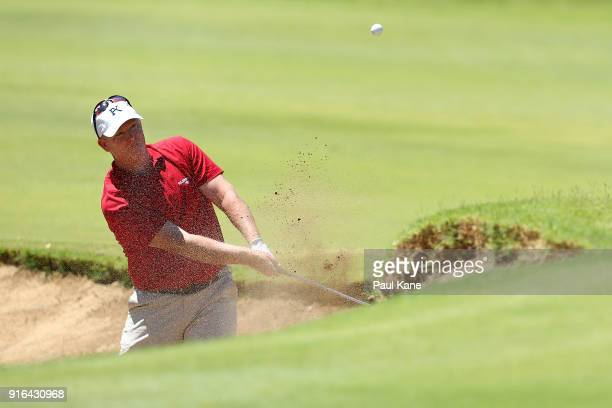 Marcus Fraser of Australia plays out from a green side bunker on the 13th hole during day three of the World Super 6 at Lake Karrinyup Country Club...