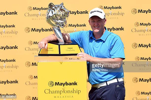 Marcus Fraser of Australia poses with the Maybank Championship Tropy after he won it 66 269 during the fourth round of the Maybank Championship...
