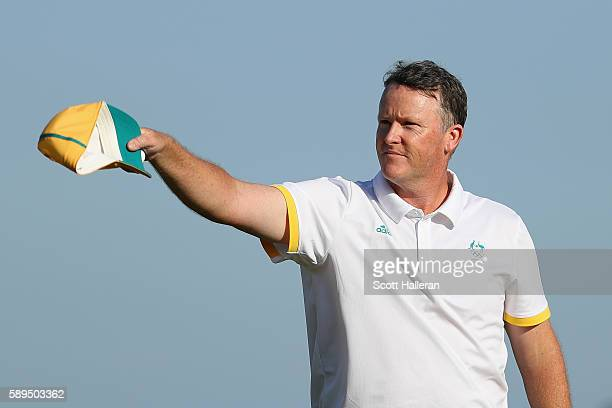 Marcus Fraser of Australia reacts on the 18th green during the final round of men's golf on Day 9 of the Rio 2016 Olympic Games at the Olympic Golf...
