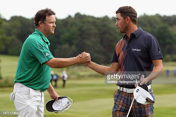 Marcus Fraser of Australia shakes hands with Oscar Floren of Sweden on the 18th hole during the afternoon's play at The Open Championship...