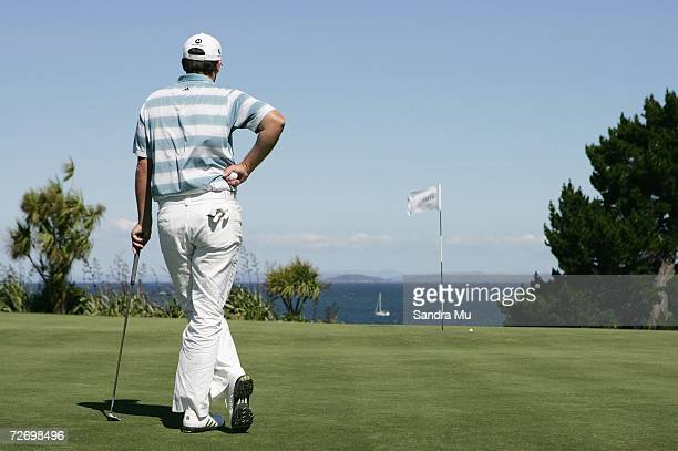 Marcus Fraser of Australia watches a boat sail past on the 16th hole during round three of the New Zealand Open at Gulf Harbour Country Club on the...