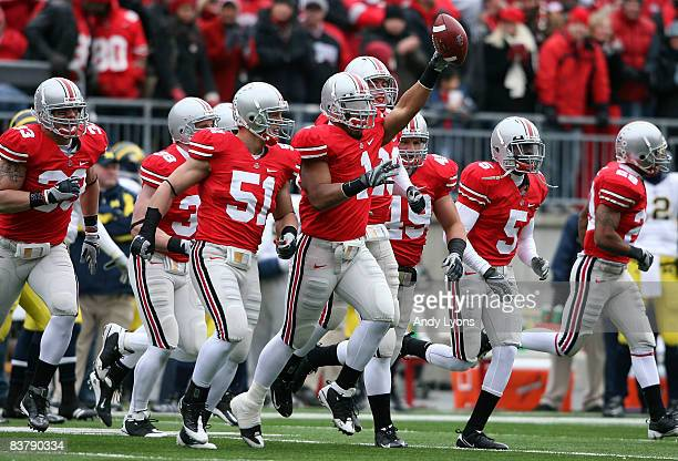 Marcus Freeman of the Ohio State Buckeyes celebraes recovering a Michigan Wolverines fumble during the Big Ten Conference game at Ohio Stadium on...