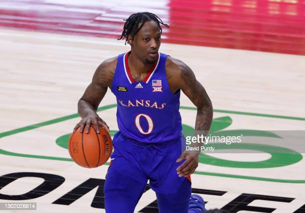 Marcus Garrett of the Kansas Jayhawks drives the ball in the first half of play at Hilton Coliseum on February 13, 2021 in Ames, Iowa. The Kansas...