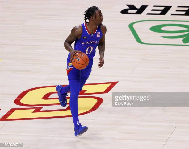 Marcus Garrett of the Kansas Jayhawks drives the ball in the second half of play at Hilton Coliseum on February 13, 2021 in Ames, Iowa. The Kansas...