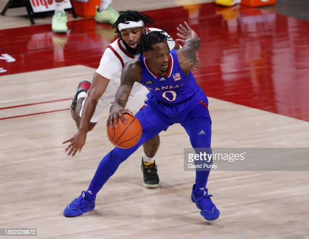 Marcus Garrett of the Kansas Jayhawks drives the ball past Tre Jackson of the Iowa State Cyclones in the first half of play at Hilton Coliseum on...