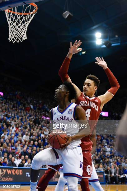 Marcus Garrett of the Kansas Jayhawks goes up to the basket against Jamuni McNeace of the Oklahoma Sooners at Allen Fieldhouse on February 19 2018 in...