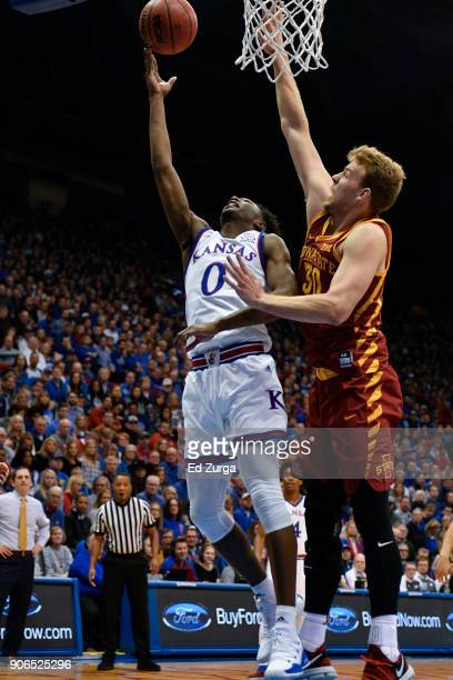 Marcus Garrett of the Kansas Jayhawks lays the ball up against Hans Brase of the Iowa State Cyclones at Allen Fieldhouse on January 9 2018 in...