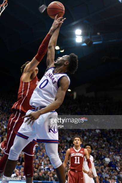 Marcus Garrett of the Kansas Jayhawks lays the ball up against the Oklahoma Sooners at Allen Fieldhouse on February 19 2018 in Lawrence Kansas