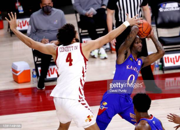 Marcus Garrett of the Kansas Jayhawks passes the ball as George Conditt IV of the Iowa State Cyclones defends in the second half of play at Hilton...