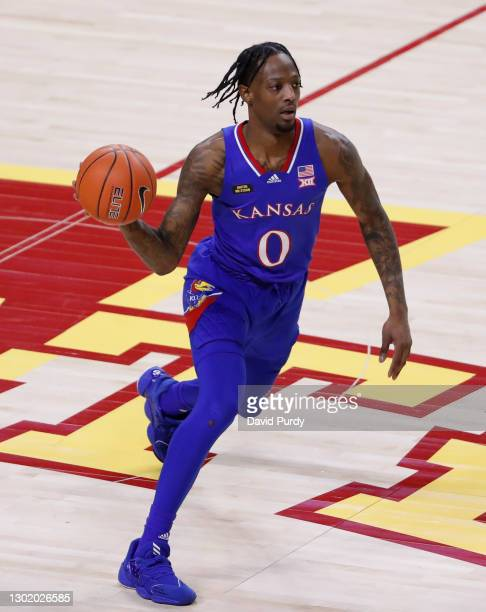 Marcus Garrett of the Kansas Jayhawks passes the ball in the first half of play at Hilton Coliseum on February 13, 2021 in Ames, Iowa. The Kansas...
