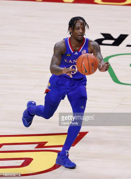 Marcus Garrett of the Kansas Jayhawks passes the ball in the second half of play at Hilton Coliseum on February 13, 2021 in Ames, Iowa. The Kansas...