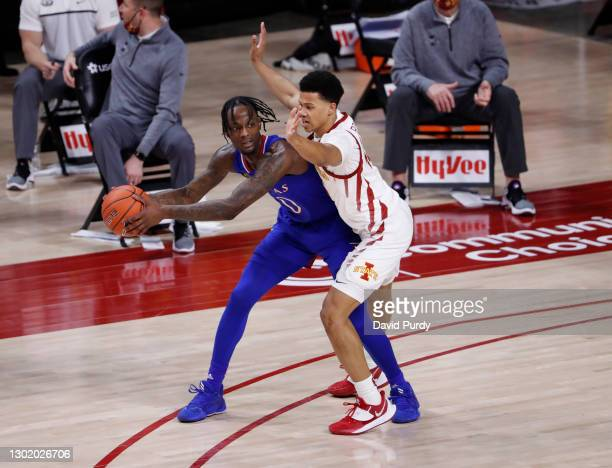 Marcus Garrett of the Kansas Jayhawks passes the ball under pressure from Rasir Bolton of the Iowa State Cyclones in the second half of play at...