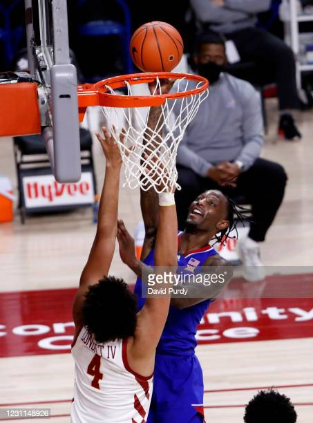 Marcus Garrett of the Kansas Jayhawks plays up a shot as George Conditt IV of the Iowa State Cyclones defends in the second half of play at Hilton...
