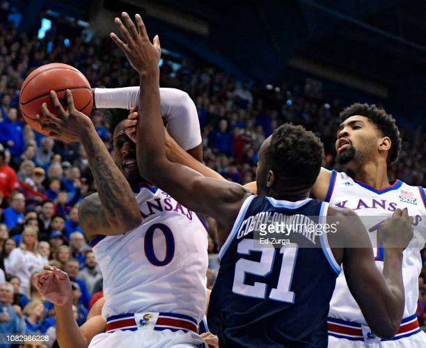 Marcus Garrett of the Kansas Jayhawks rebounds a ball against Dhamir CosbyRoundtree of the Villanova Wildcats in the first half at Allen Fieldhouse...